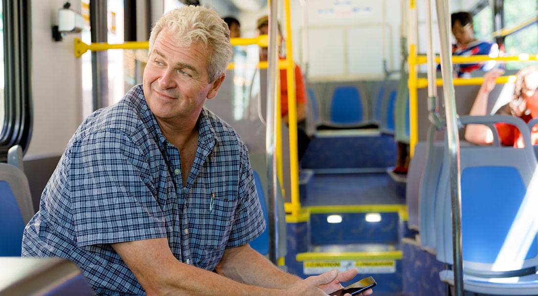 man sitting on a bus